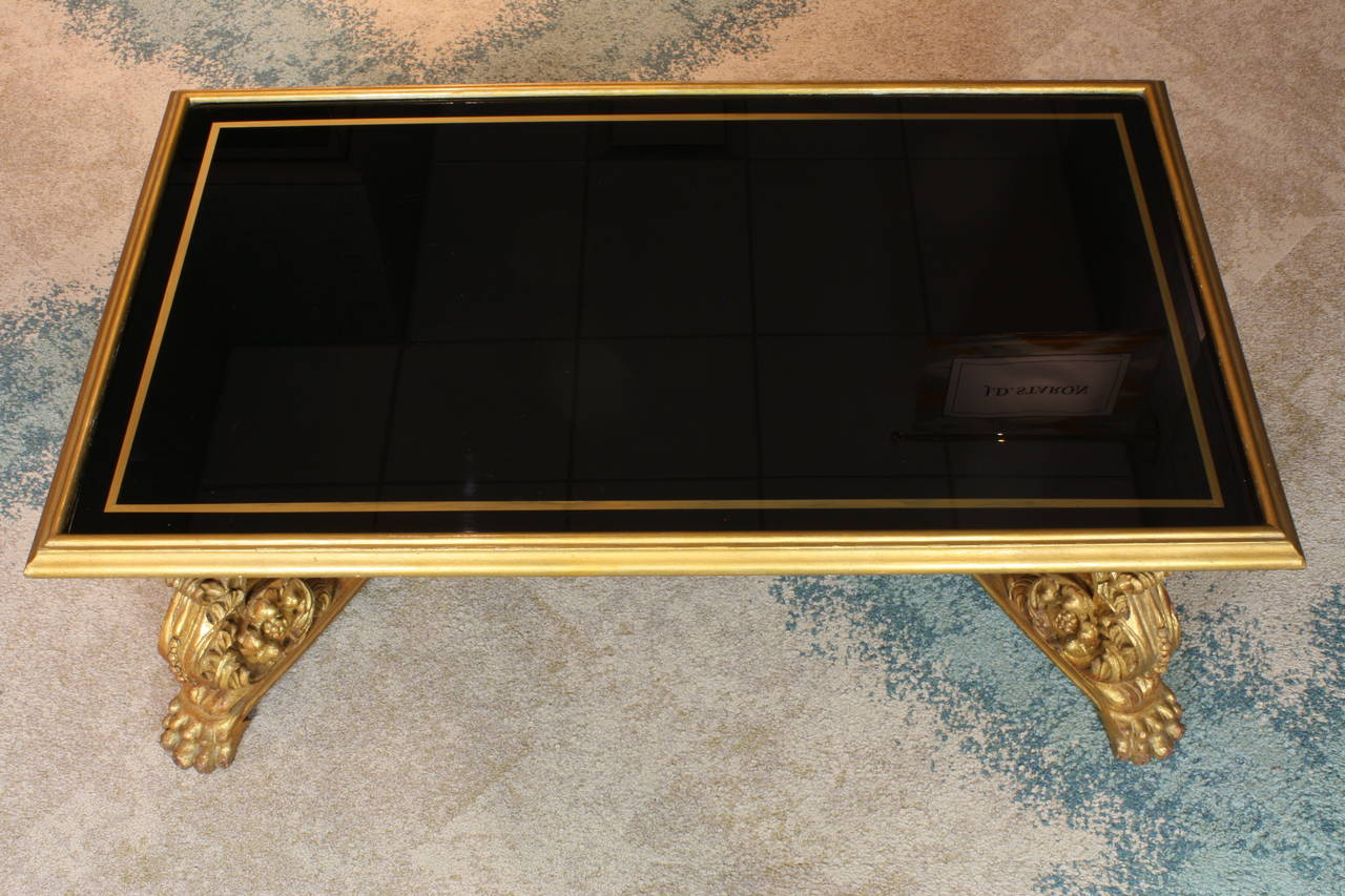Carved French Giltwood and Black Glass-Top Coffee Table by Hirsch For Sale