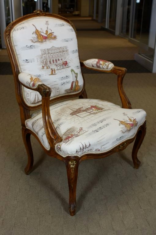 Hand-Carved Pair of French Louis XV Style Fauteuils with Mozart and Music Themed Toile For Sale
