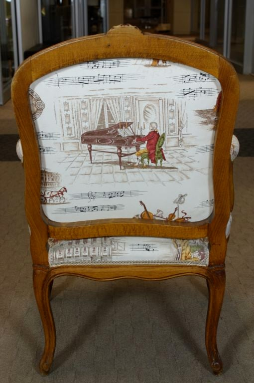 20th Century Pair of French Louis XV Style Fauteuils with Mozart and Music Themed Toile For Sale