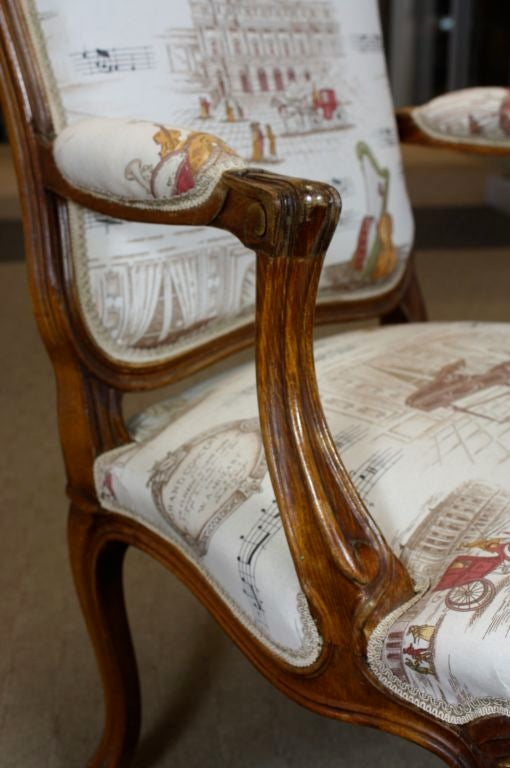Fruitwood Pair of French Louis XV Style Fauteuils with Mozart and Music Themed Toile For Sale