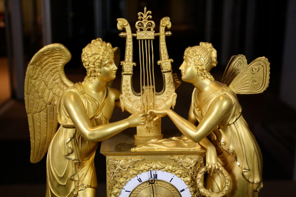 French Empire period gilt-bronze clock featuring Cupid, the son of Venus (also known as