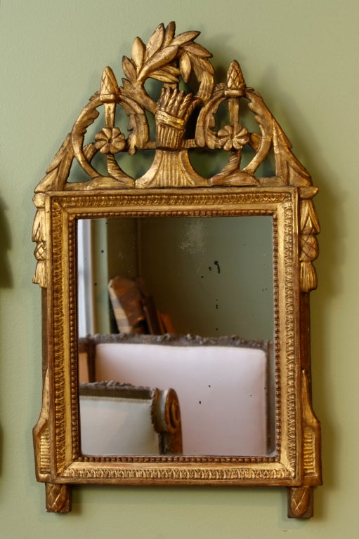 A petit French Directoire period giltwood trumeau mirror with sheath of wheat cartouche and other neoclassical detailing (Circa 1790).  Nice old mercury glass.  A similarly-sized French Louis XVI period giltwood