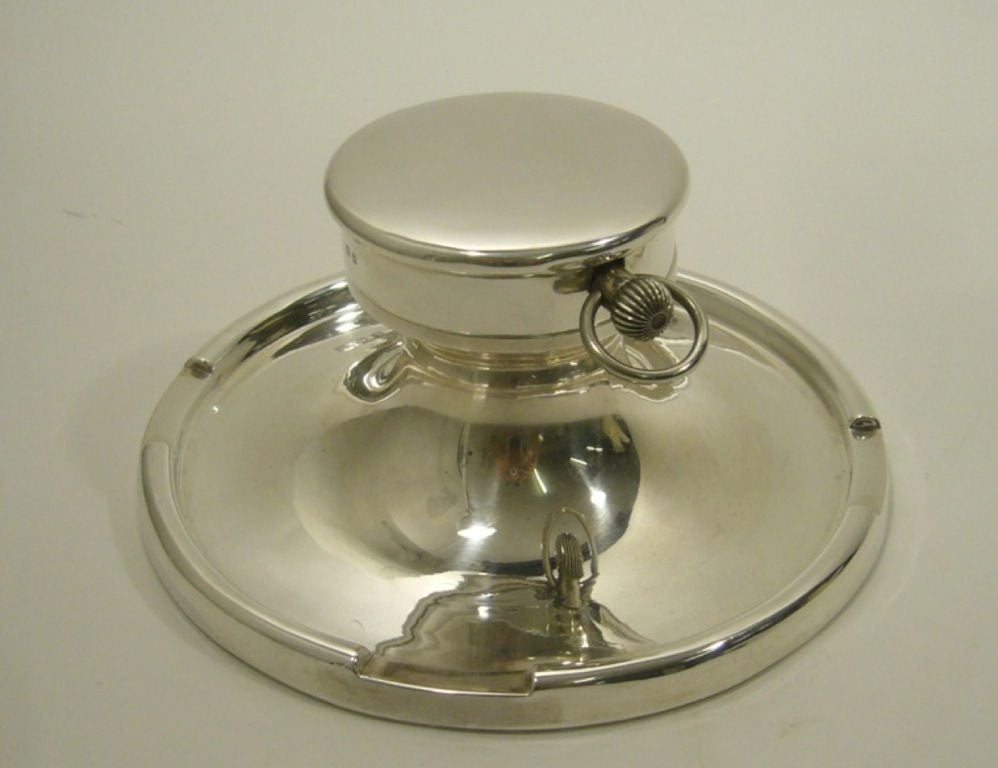 A striking Captain's Silver Clock Inkwell, with silver marks of Birmingham 1912, rubbed makers mark