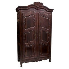 Elaborately Carved French Walnut and Fruitwood Armoire