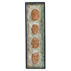 Wall Sculpture Featuring Four Resin Faces, England, 1940s