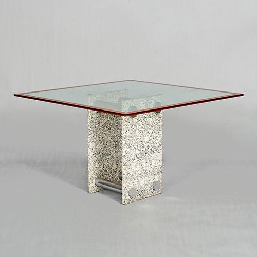 Stone based dining table with metal stretchers and glass top. The top has a matching colour band around the edge.  The four chairs are in their original upholstery with metal detail.  Chair dimensions: (H) 110cm; (H2) 46cm; (W) 43cm; (D)43cm