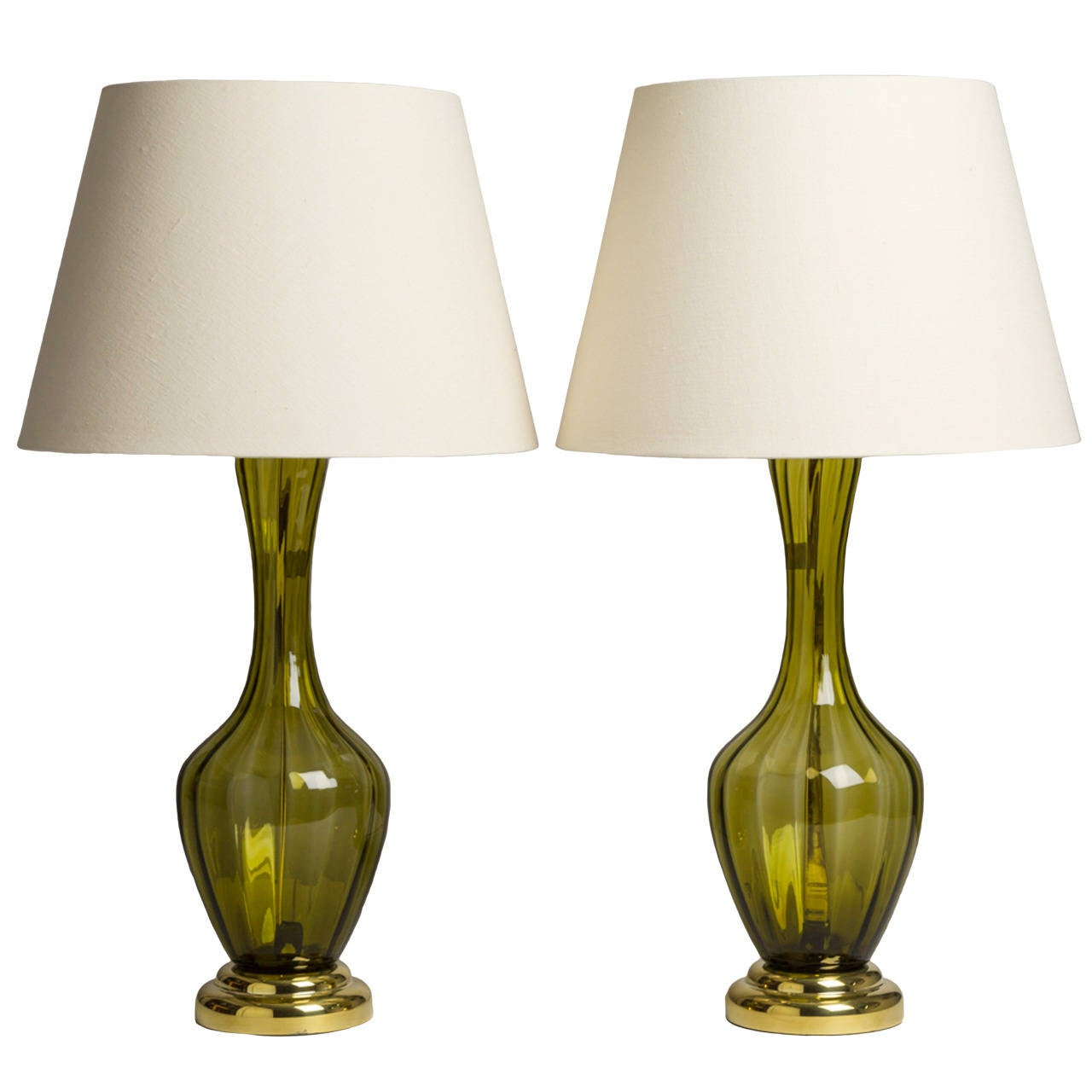 this a pair of olive green glass table lamps on circular bases is no. Black Bedroom Furniture Sets. Home Design Ideas