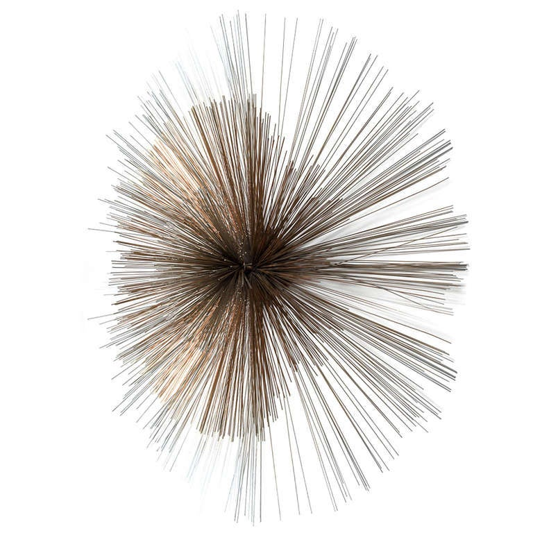 A Large Starburst Metal Wall Sculpture By Curtis Jere