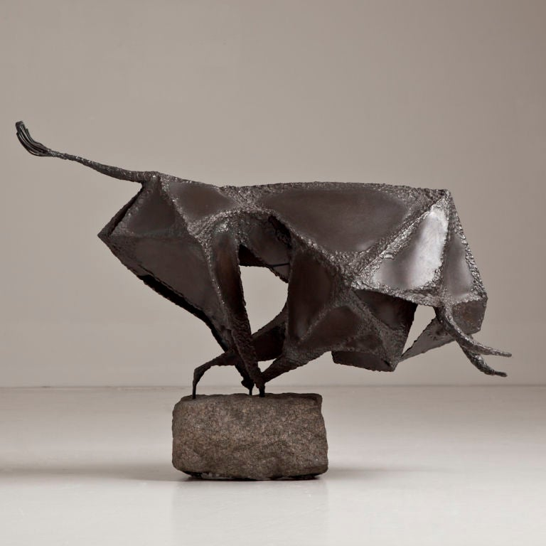a brutalist metal sculpture of a charging bull image 2. Black Bedroom Furniture Sets. Home Design Ideas