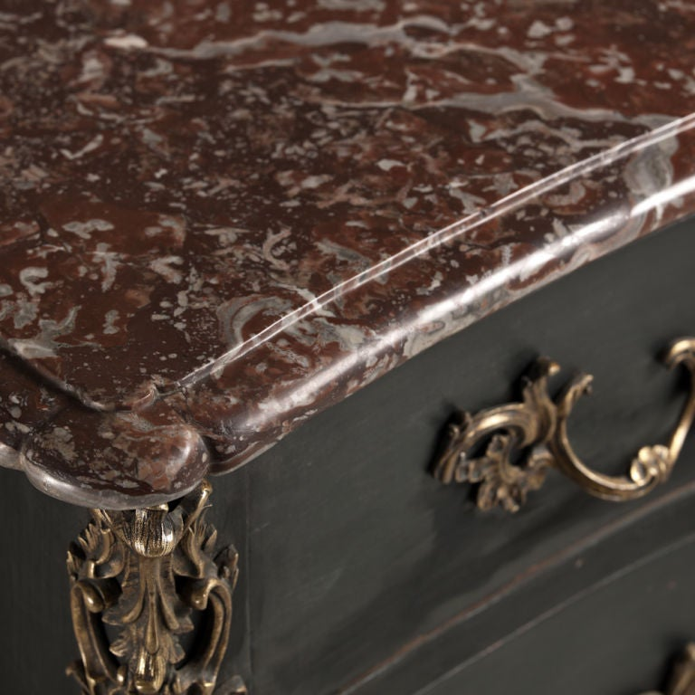 A superb French Provincial oak commode with original hand-cut marble top and ormolu mounts, circa 1760.