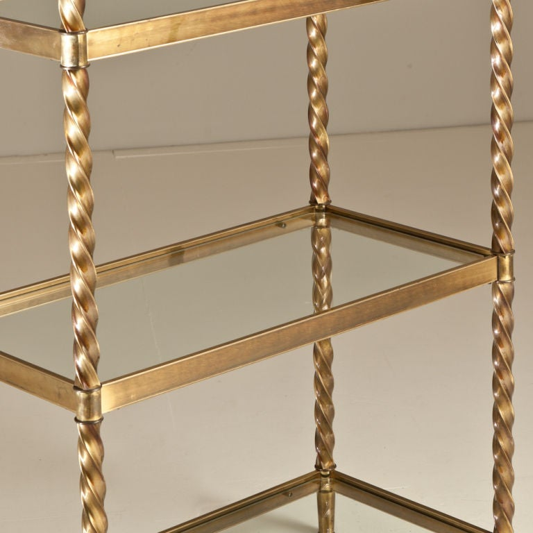 A Mastercraft Brass Framed Etagere With Glass Shelves At