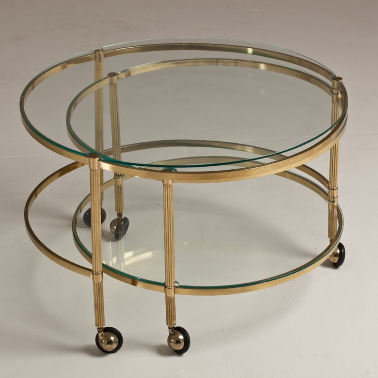 A Two Tiered, Brass Framed Swivel Extending Coffee Table