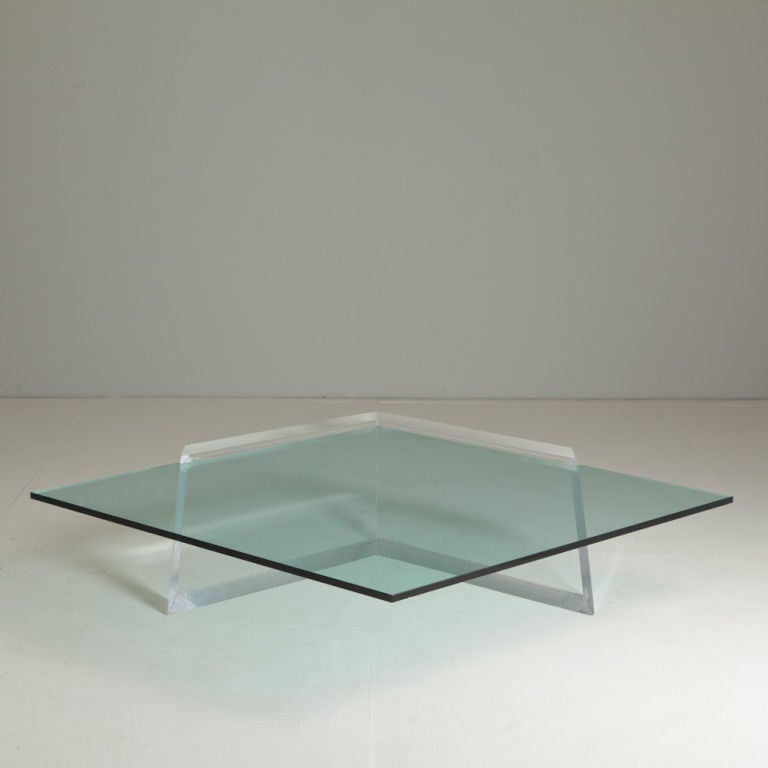 A stunning heavy lucite cantilevred coffee table with for Heavy glass coffee tables