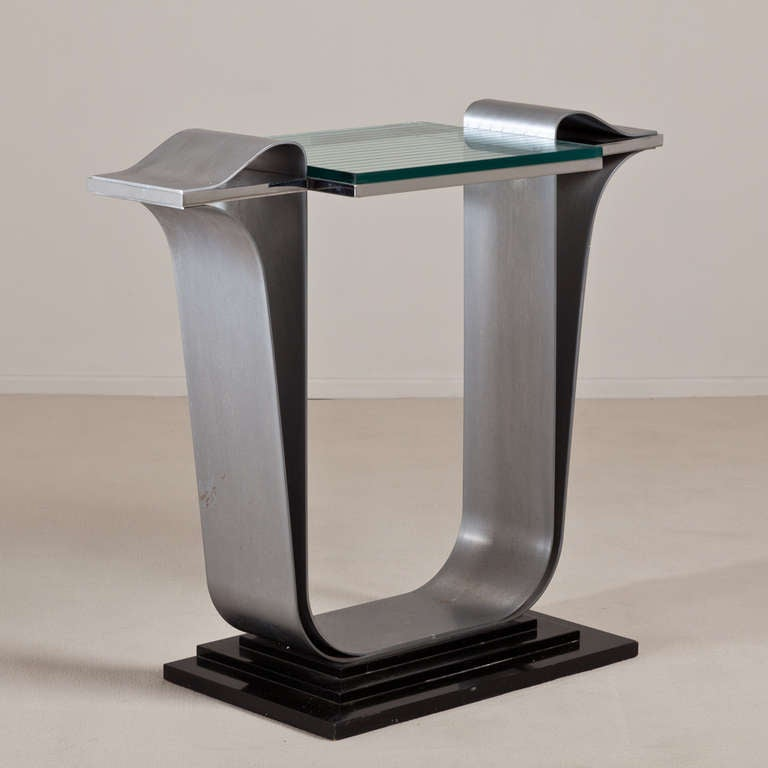 A Jay Spectre designed brushed and polished steel console table with linear etched glass top on ebonized base, 1980s.