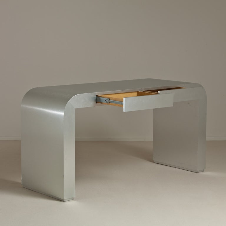 A Brushed Steel Mica Wrapped Waterfall Shaped Desk 1970s