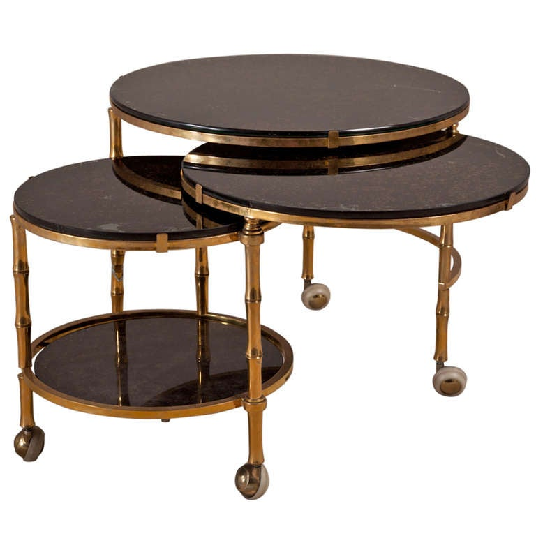 A three tiered brass and eglomise swivel side table s