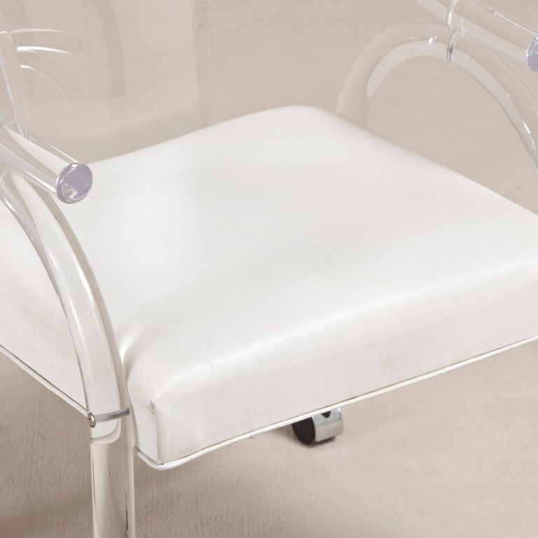 This four wishbone chairs by hans wegner is no longer available - A Set Of Four Lucite Carver Chairs On Castors 1970s At 1stdibs