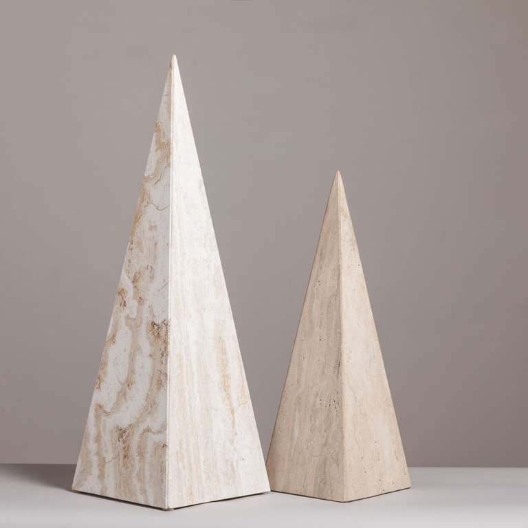 A pair of marble obelisk sculptures, 1980s. The finishes of the two obelisks are different the taller one is smooth and shiny and the smaller one is in a matte finish.   Measures: Smaller 20cm x 20cm x 59cm high.