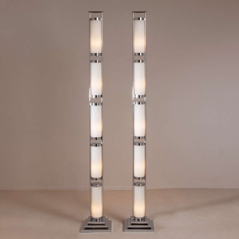 A Pair Of Tall Chrome And Glass Deco Style Floor Lamps At