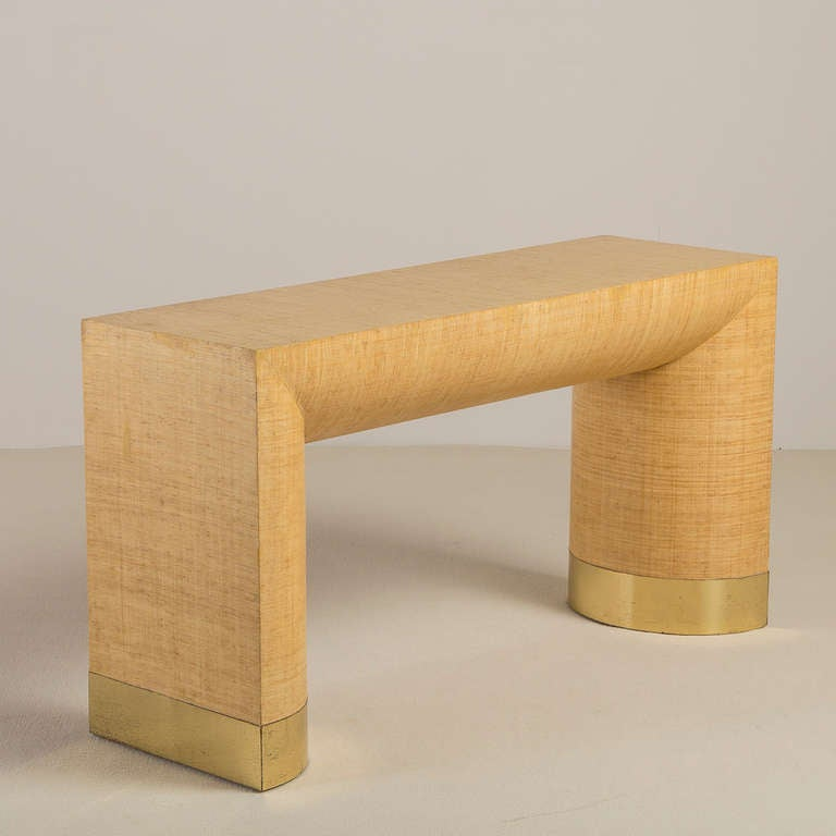 A rattan wrapped Karl Springer style console table with brass detail, 1970s  Prices include 20% VAT which is removed for items shipped outside the EU.