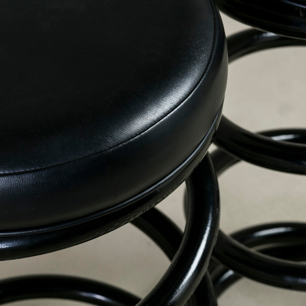 Pair Of Helix Shaped Black Steel Upholstered Bar Stools