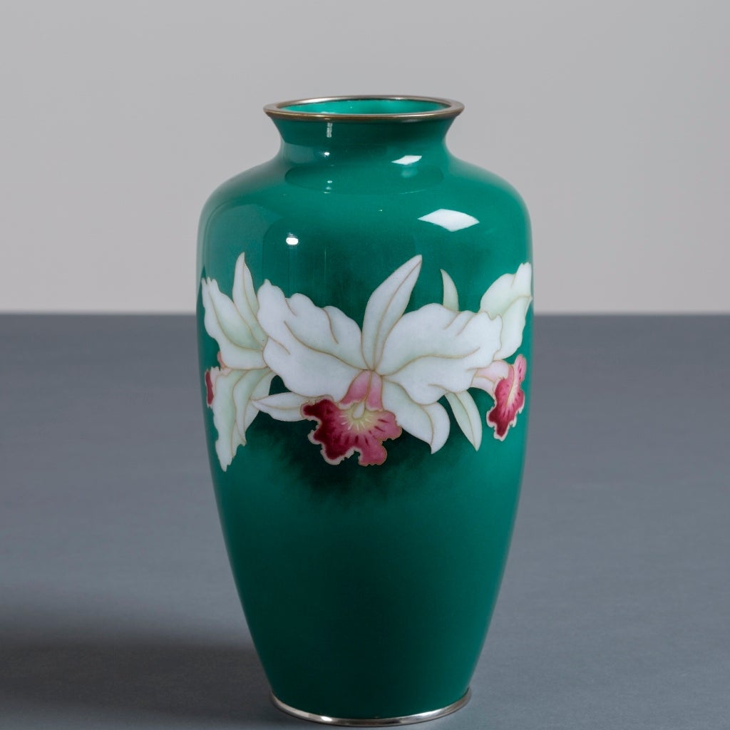 A Japanese cloisonné enamel vase depicting two orchids from the late Showa period