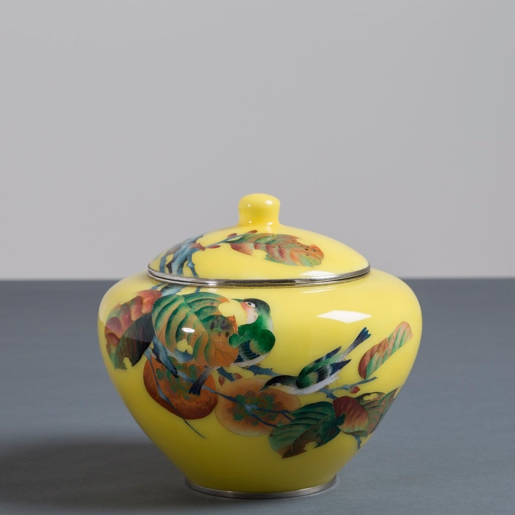 A Japanese cloisonné yellow enamel vase depicting green bird and leaves attributed to Shobido.