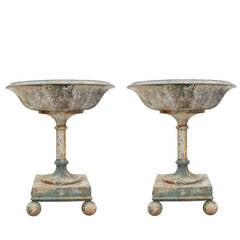 Massive Pair or Cast Iron Urns