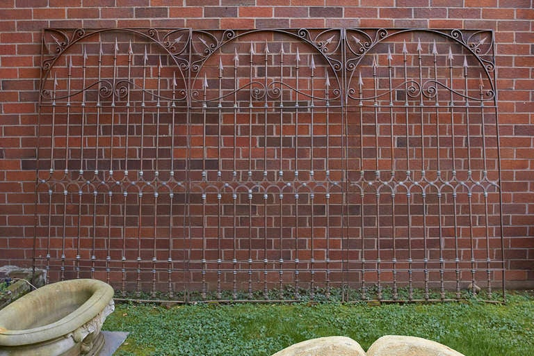 Set of three, 19th century Chilean hand-forged wrought iron grills with lead decorations. Exceptional design and form noted in spears and lead decorations. Ideal for us in a wine cellar or solarium. The overall length of the set of three gates when