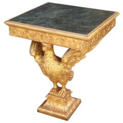 A Very Finely Carved and Gilded Marble Topped Console Table
