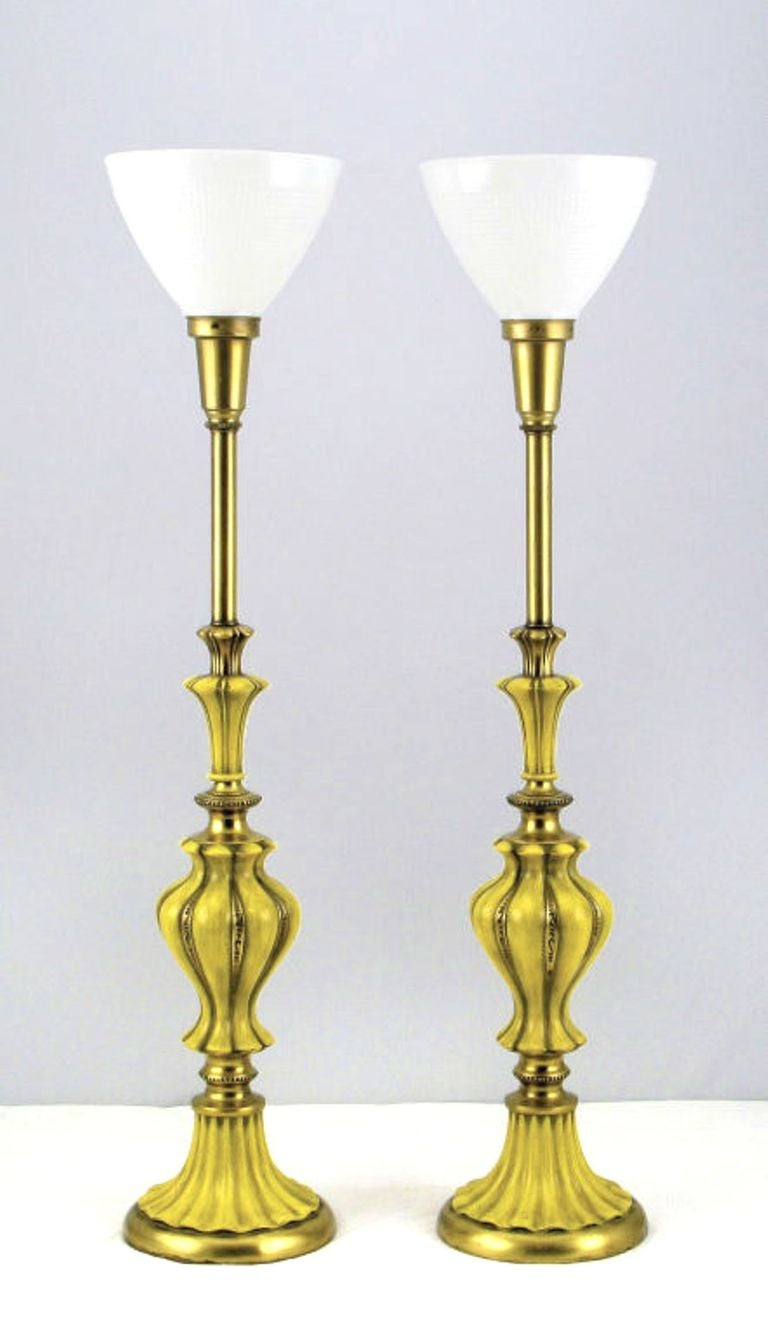 An elegant and beautifully lacquered pair of table lamps from one of the foremost lighting design firms, Rembrandt. The brass has a wonderful patina and the saffron lacquer has been antiqued to aged perfection. A truly exceptional pair of table