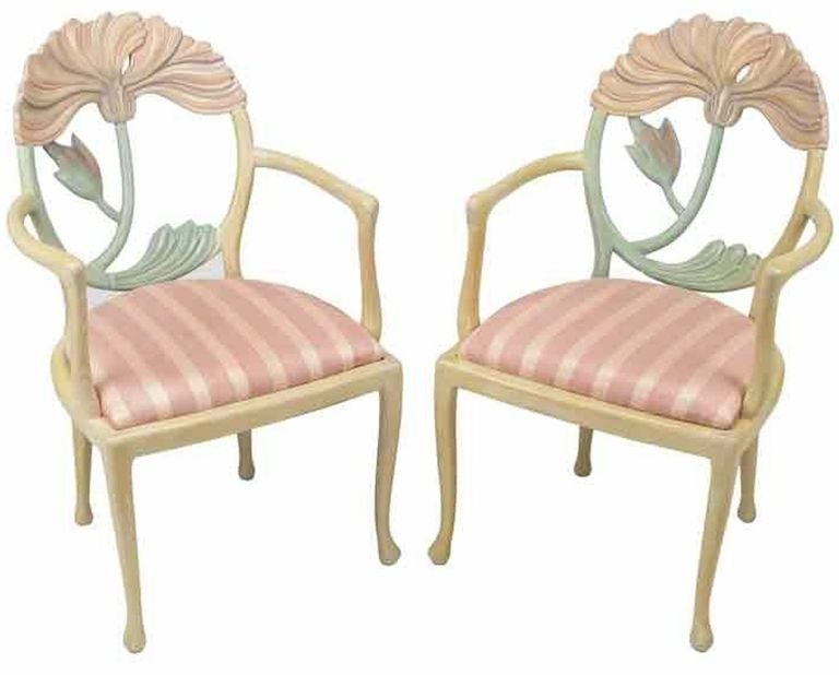 An inspired rendition of a traditional form, these Italian made armchairs have large floral carvings of poppies within oval backs, slightly cabriole legs and striped pink silk upholstered seats. Purchased with a Phyllis Morris bed and dresser from