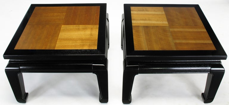 Pair of ebonized Ming style low tables with natural contrasting grain alder wood parquetry tops. Can be used as a two piece coffee table or low end tables. Excellent build quality and restored to original condition.