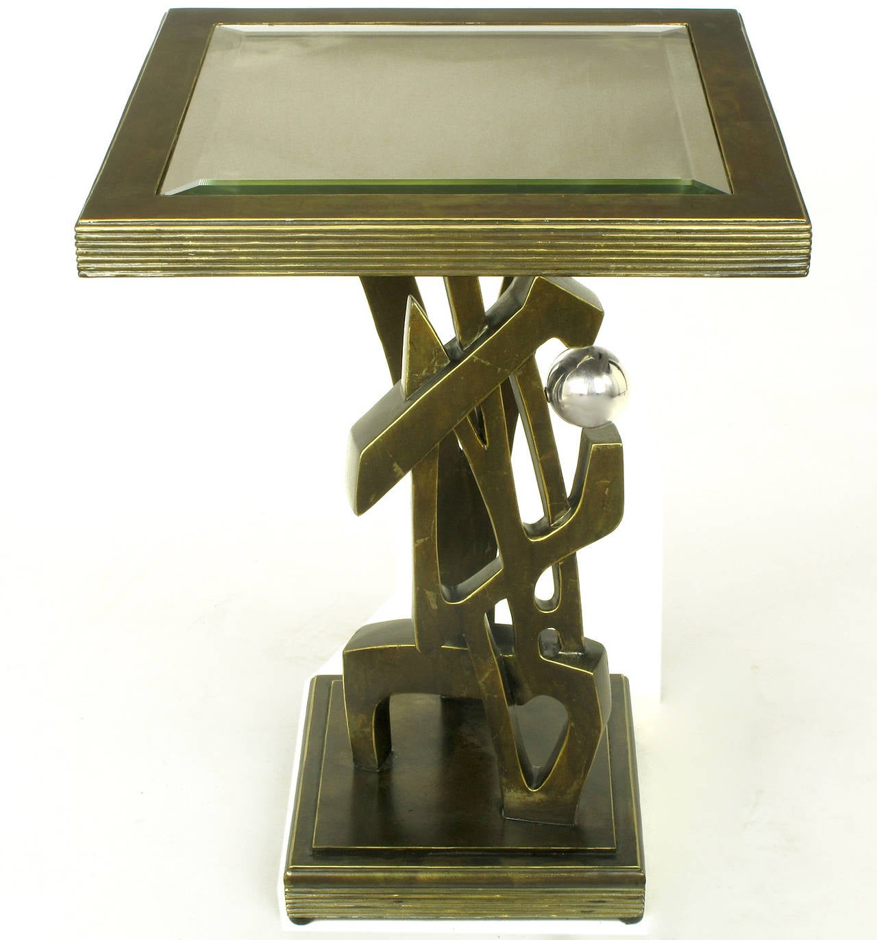 Artisan sculpted bronze over resin and metal side table. Architecturally inspired body on tiered plinth base with metal V-shaped support and chrome ball. Top is cast resin and metal with a beveled mirror insert. Unsigned.