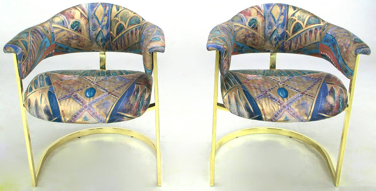 Excellent design and incredible comfort, these cantilevered armchairs are very much like designs Milo Baughman produced for Thayer Coggin. The brass bar is of good weight and the center bar that runs from the top of the back down under the chair
