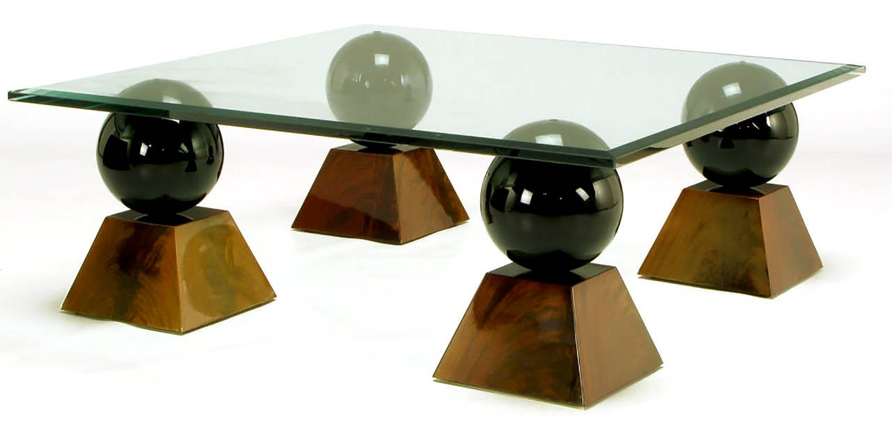 Italian Coffee Table of Glass Top over Black Spheres on Mahogany Pyramids In Good Condition For Sale In Chicago, IL