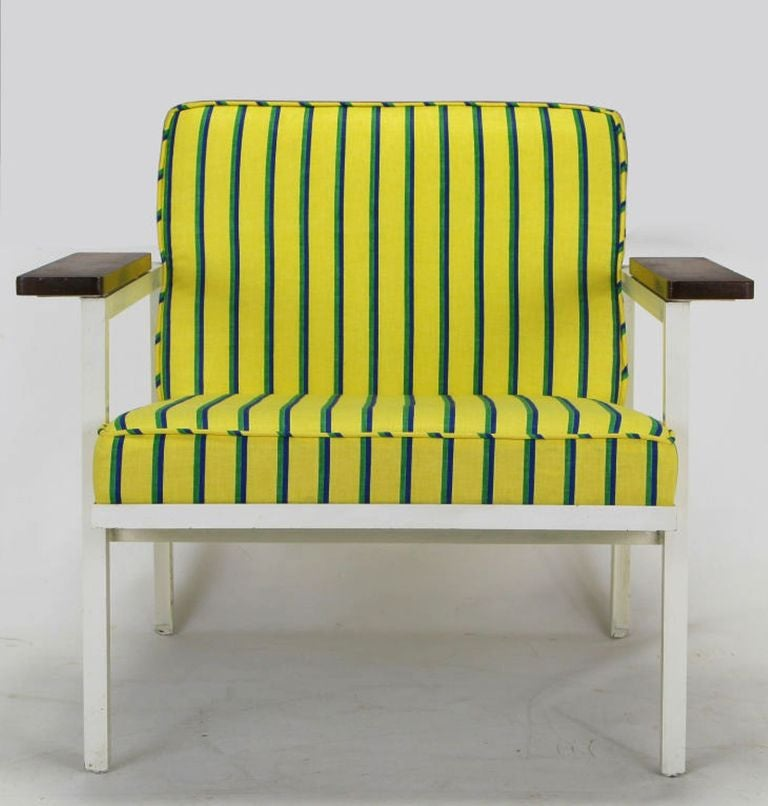 Early and rare George Nelson Associates designed #5080 steel framed arm chair for Herman Miller. This example has been restored with white lacquered steel frame, walnut arms and a striped yellow, blue and green cotton upholstery.