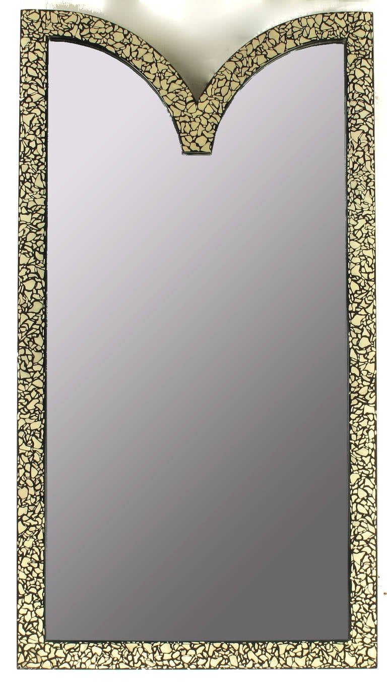 Excellent faux mother-of-pearl and black lacquered mirror. Expertly done with iridescence translated though color variance. Uncommon shape, can be hung with the V at the bottom or top.