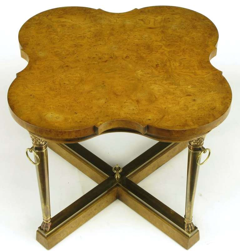 Taking cues from French Empire design, Mastercraft executed this stunning side table with a modern twist. Acanthus leaf details, lions paw feet, rings of bronze, lower finial, with a burl wood quatrefoil top.