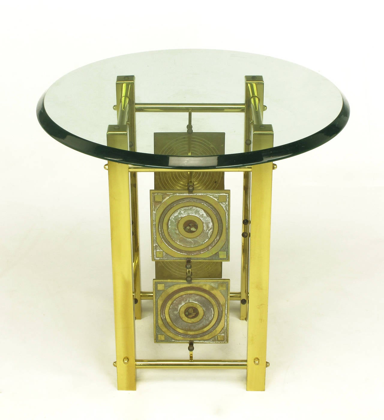 One of a kind artist studio Postmodern brass and enameled brass panel side table with glass top. Each panel was cast and enameled then suspended two to a side with brass bars and clips with brass ball detail. Similar in style to the acid etched