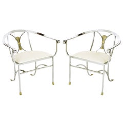 Pair of Polished Iron and Brass Scroll Armchairs