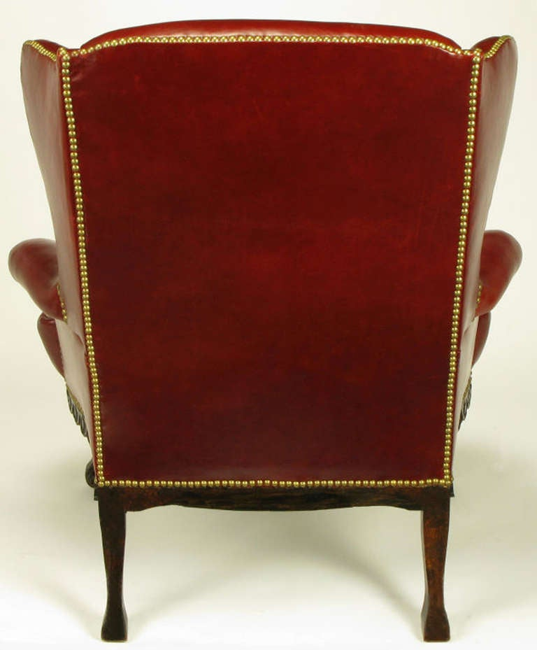 Circa s red leather and carved walnut wing chair at