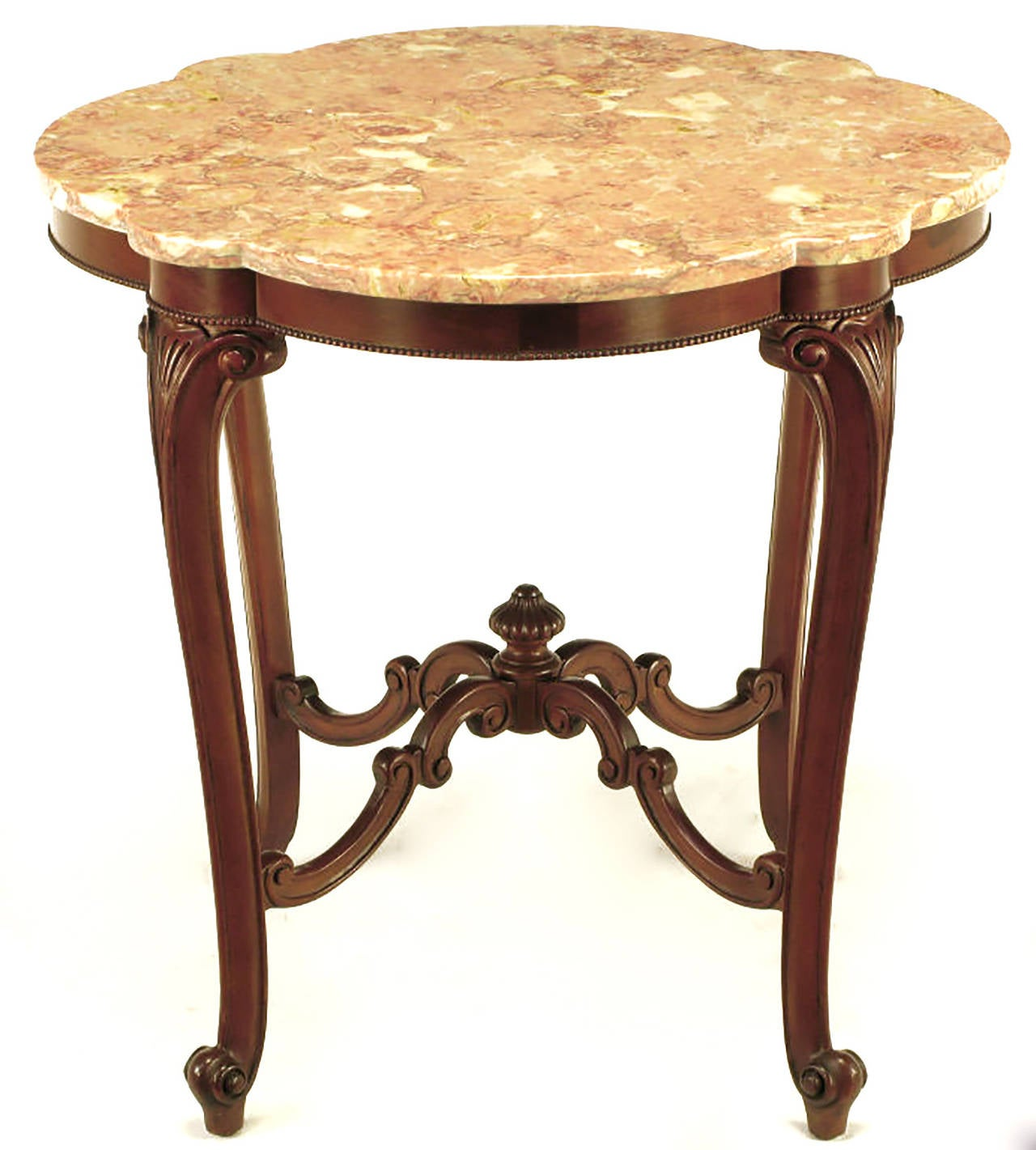 Ornately carved mahogany octofoil centre table with rouge marble top. Turned feet on splayed legs with beaded apron. Upwardly bowed four part stretcher with center finial.