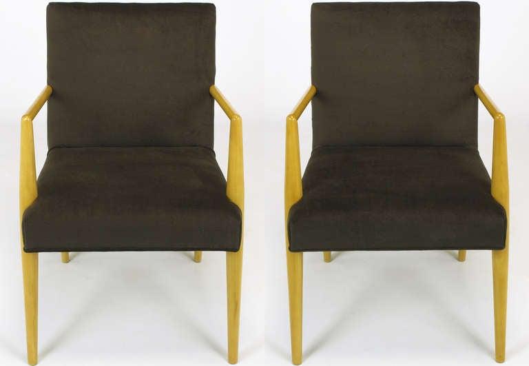 Restored T.H. Robsjohn-Gibbings maple framed open armchairs with new dark chocolate wool upholstery.