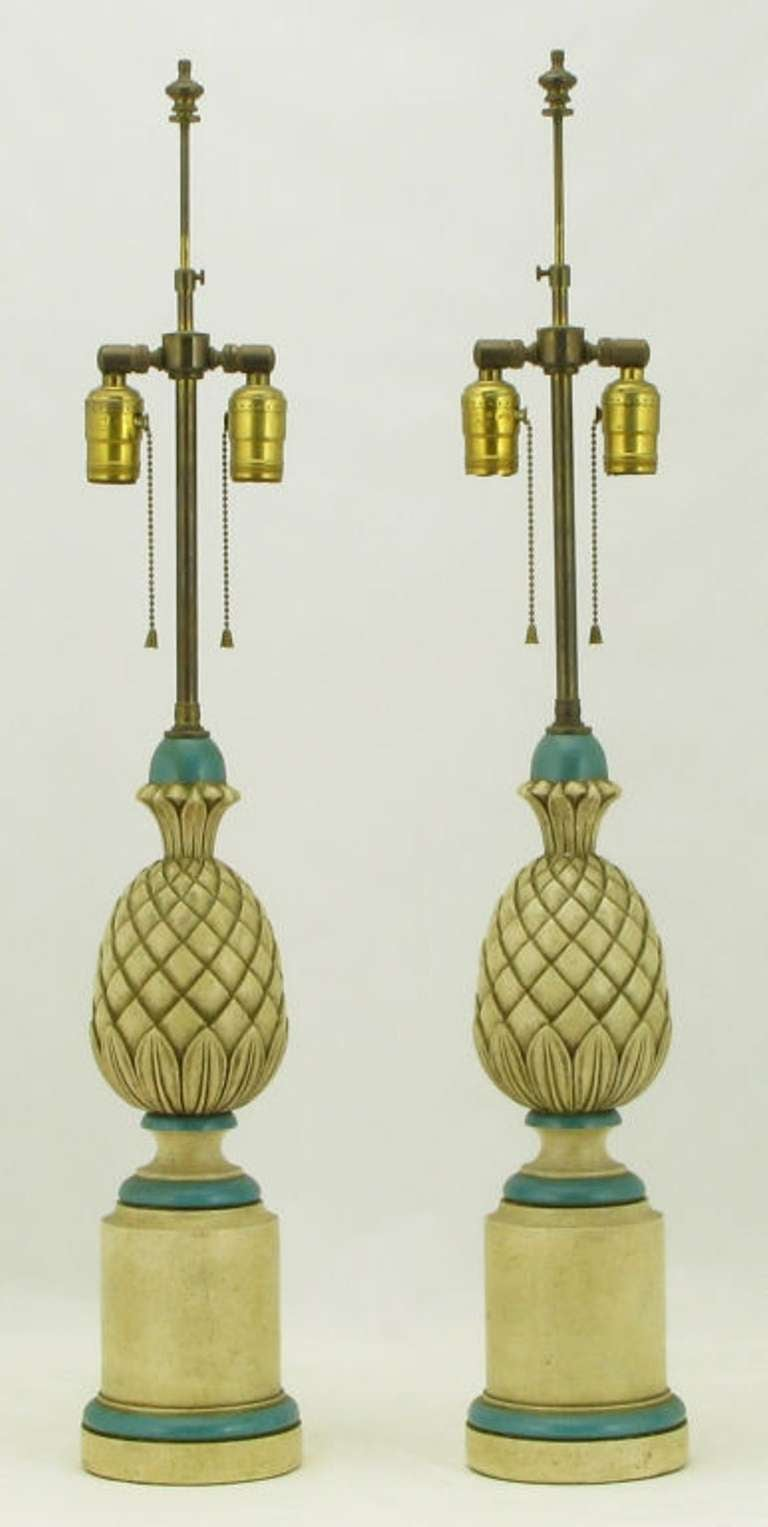 Fine pair of Regency style table lamps constructed of cast gesso and plaster. Lacquered in a creamy antique white, with Robin's egg blue accents and parcel-gilt edging. Dual lighting element and chain pull switches. Sold sans shades.