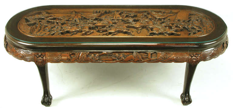 Chinese Oval Coffee Table with Hand-Carved Battle Scene and Six Stools In Excellent Condition For Sale In Chicago, IL