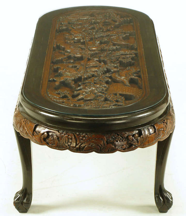 Late 20th Century Chinese Oval Coffee Table With Hand Carved Battle Scene And Six Stools