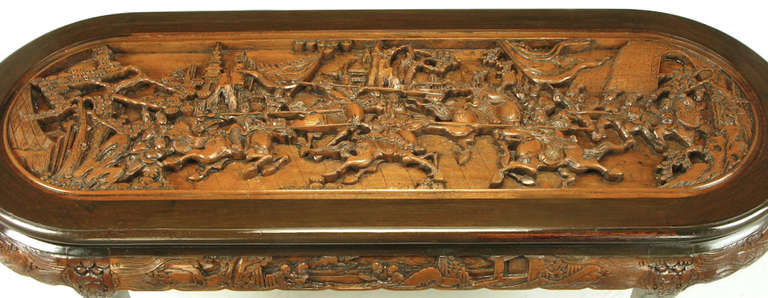 Wood Chinese Oval Coffee Table with Hand-Carved Battle Scene and Six Stools For Sale