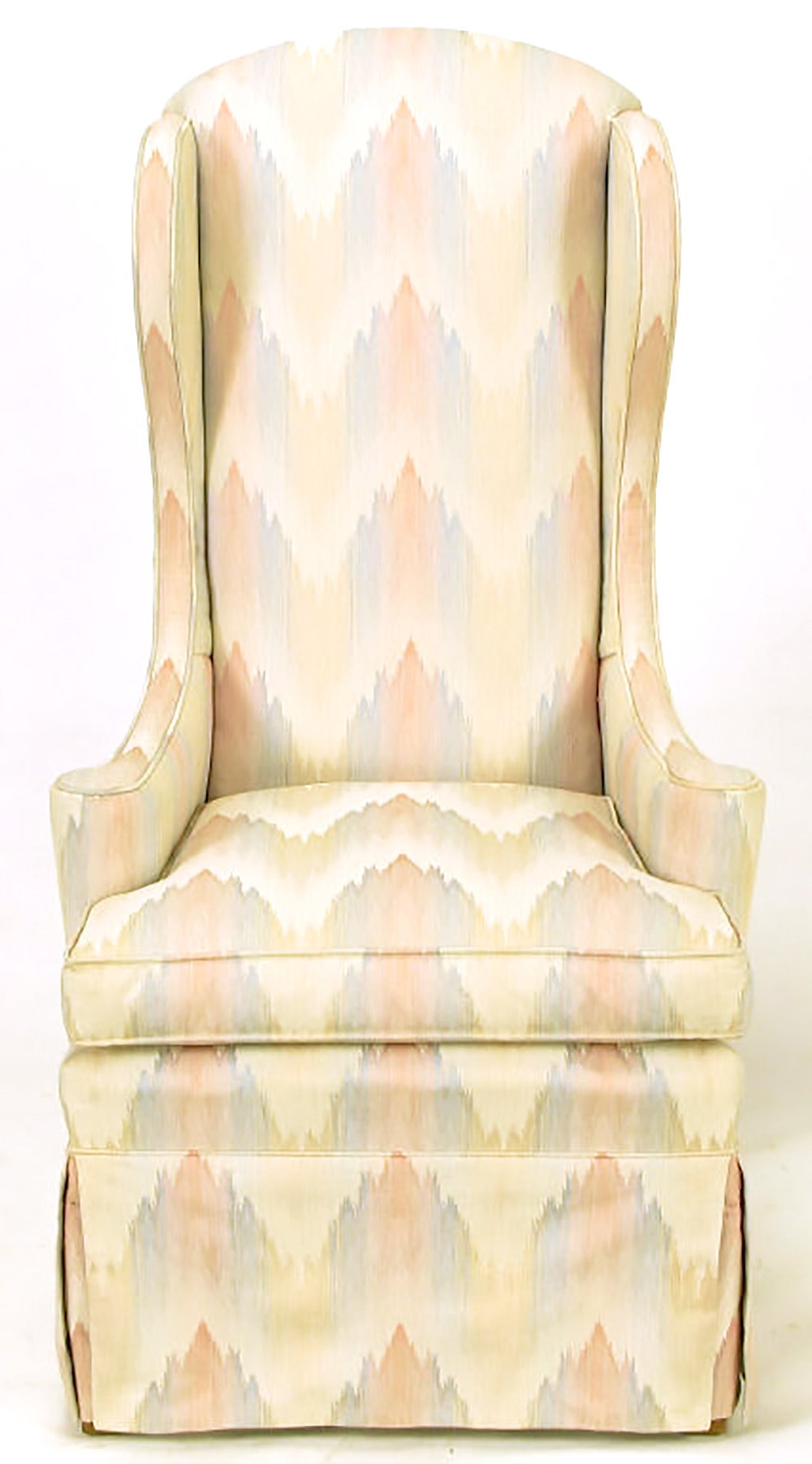 Pair of elegant wing chairs upholstered in a muted lavender, blush and cream flame stitch silk blend. Narrow and arched top back, slight rake in profile and low slung out turned arms lend updated appeal to the Classic wingback chair. Currently