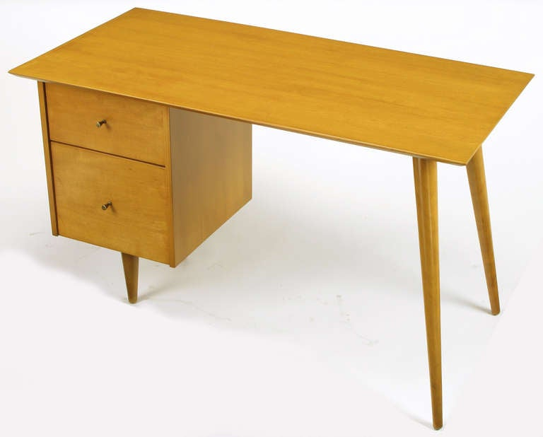 Masterfully restored to original condition, Paul McCobb Planner Group for Winchendon two drawer desk or writing table. Maple wood with brass conical pulls possessing the slightest patina.